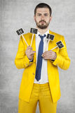 Businessman holds a sign HELP. Wearing a gold suit Royalty Free Stock Photos