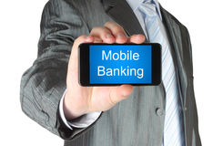 Businessman holds smart phone with mobile banking words Royalty Free Stock Photography