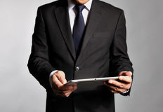 Businessman holds a  table pc Stock Photo