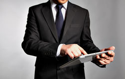 Businessman holds a  table pc Stock Image