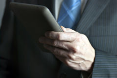 Businessman Holds Tablet Computer Royalty Free Stock Photo