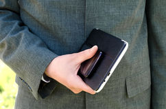 Businessman holds the tablet and phone Stock Images