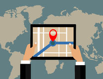Businessman holds tablet and world map with location pointer Stock Photos