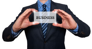 Businessman holds white card with Business sign, White - Stock P Royalty Free Stock Photo