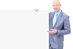 Businessman holds white poster. Royalty Free Stock Photography