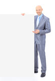 Businessman holds white poster. Stock Photography