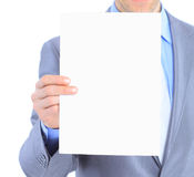 Businessman holds white poster. Stock Images