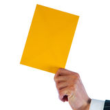 Businessman holds a yellow envelope isolated on a white backgrou Royalty Free Stock Photo