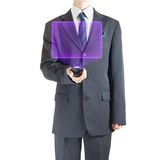Businessman with holographic projector Stock Photography