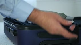 Businessman at Home Arrange Clean Clothes in Suitcase for a Business Travel.  stock video footage