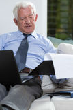 Businessman in home Stock Photos