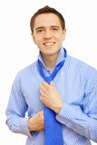 Businessman at home making his tie Royalty Free Stock Photo