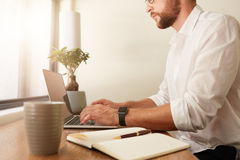 Businessman at home office working on laptop Royalty Free Stock Images