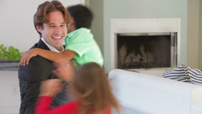 Businessman Home From Work Greeted By Children stock video footage