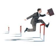 Businessman hoppig over barrier Stock Photography