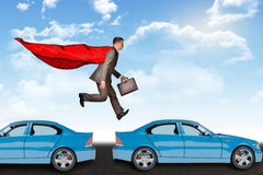Businessman hopping cars Royalty Free Stock Photography