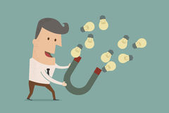 Businessman with horseshoe magnet collecting  light bulb Stock Image