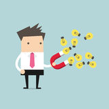Businessman with horseshoe magnet collecting light bulb Royalty Free Stock Image