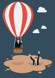 Businessman in hot air balloon get away from quicksand Stock Images