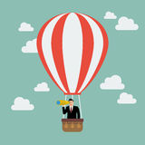 Businessman in hot air balloon search to success Stock Photo