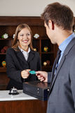 Businessman in hotel at reception Stock Photo