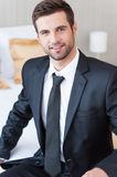 Businessman in hotel room. Royalty Free Stock Image