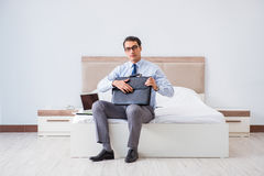 The businessman in the hotel room during travel Stock Photos