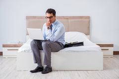 The businessman in the hotel room during travel Royalty Free Stock Image