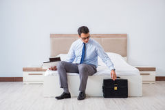 The businessman in the hotel room during travel Stock Photography