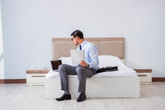 The businessman in the hotel room during travel Royalty Free Stock Photo