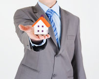 Businessman with a house Stock Image