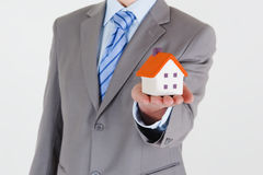 Businessman with a house Stock Photo