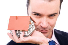 Businessman with house Stock Image