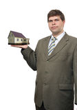 Businessman with house in hand Royalty Free Stock Photography