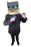 Businessman with a house head Stock Photography