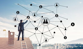 Businessman on house roof presenting networking and connection c Stock Photo