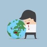 Businessman hug the world Royalty Free Stock Photos