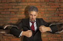 Businessman with huge chain Stock Photography