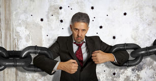 Businessman with huge chain Royalty Free Stock Image
