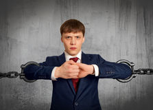 Businessman with huge chain Stock Photo