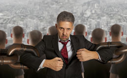 Businessman with huge chain Royalty Free Stock Photos