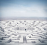 Businessman and huge maze. 3d rendering Stock Photo