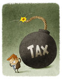 Businessman with a huge tax bomb Stock Images