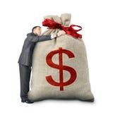 Businessman hugging big bag with dollar sign Stock Photo