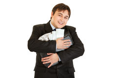 Businessman hugging briefcase with money in hands Royalty Free Stock Photos