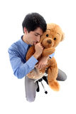 Businessman hugging a teddy bear. Royalty Free Stock Photos