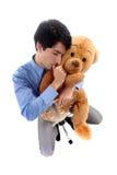 Businessman hugging a teddy bear. Royalty Free Stock Photos