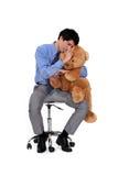 Businessman hugging a teddy bear. Stock Photos