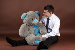 Businessman hugging a teddy bear Royalty Free Stock Image