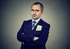 Businessman with hundred dollar banknote in his jacket pocket. Businessman with one hundred dollar banknote in his jacket pocket Royalty Free Stock Photos